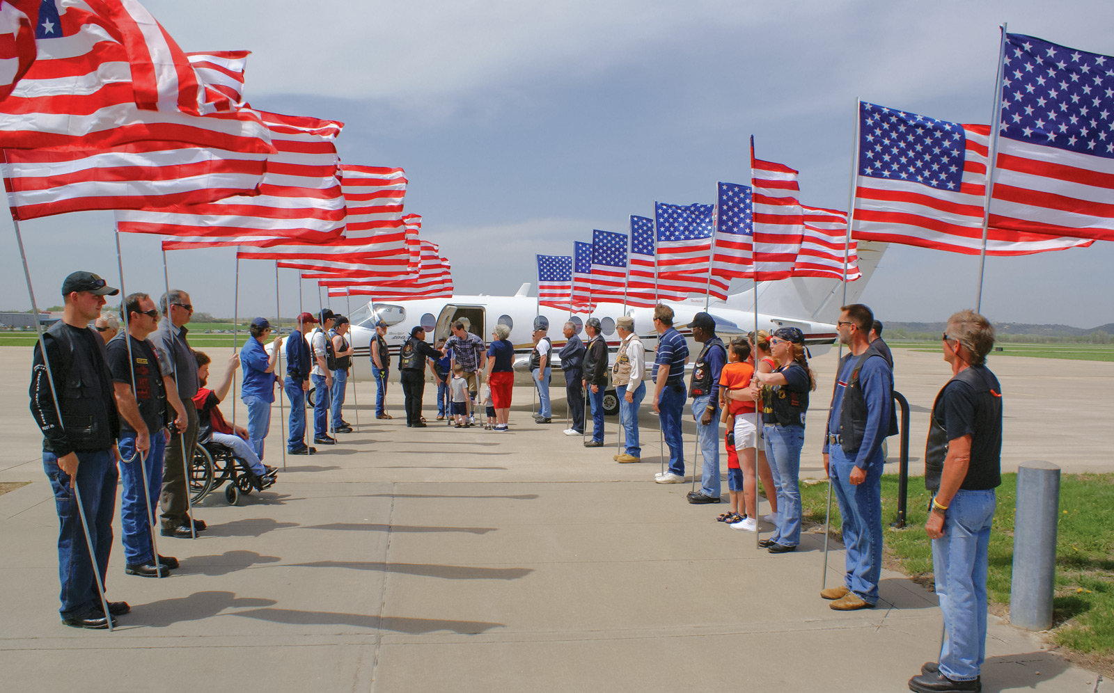 TAMKO's first-ever VAC Hero Flights mission - veteran welcomed home with flags - May 2008